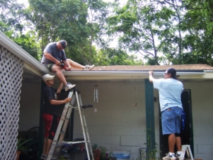 Installing gutters, downspouts, and a rain barrel